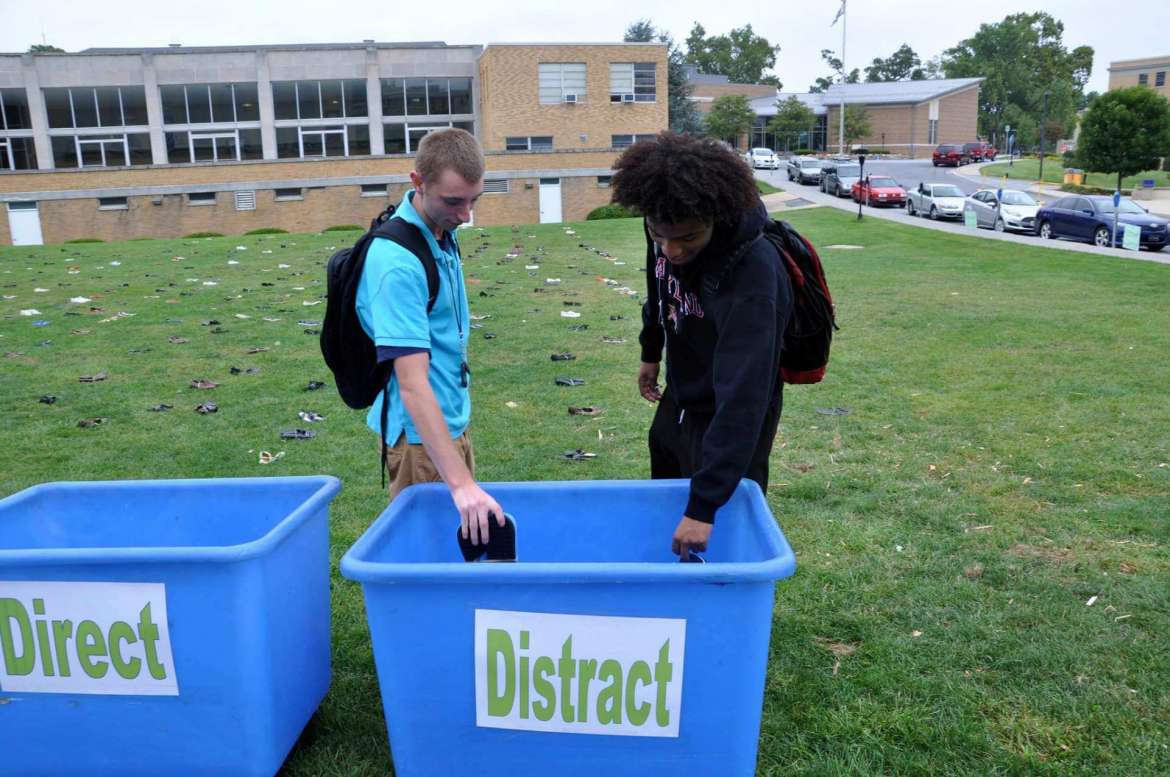 Students placed shoes in one of three bins to represent how they'd handle a situation.