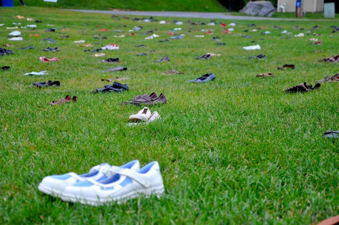 More than 500 pairs of shoes were laid on the midway to represent the number of both male and female Shepherd students who could potentially be touched by sexual assault during their time in college.