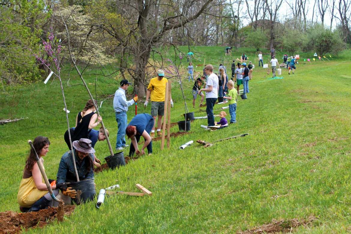 Students and faculty volunteer planted native hardwood trees on the berm behind the Shepherd's soccer field.