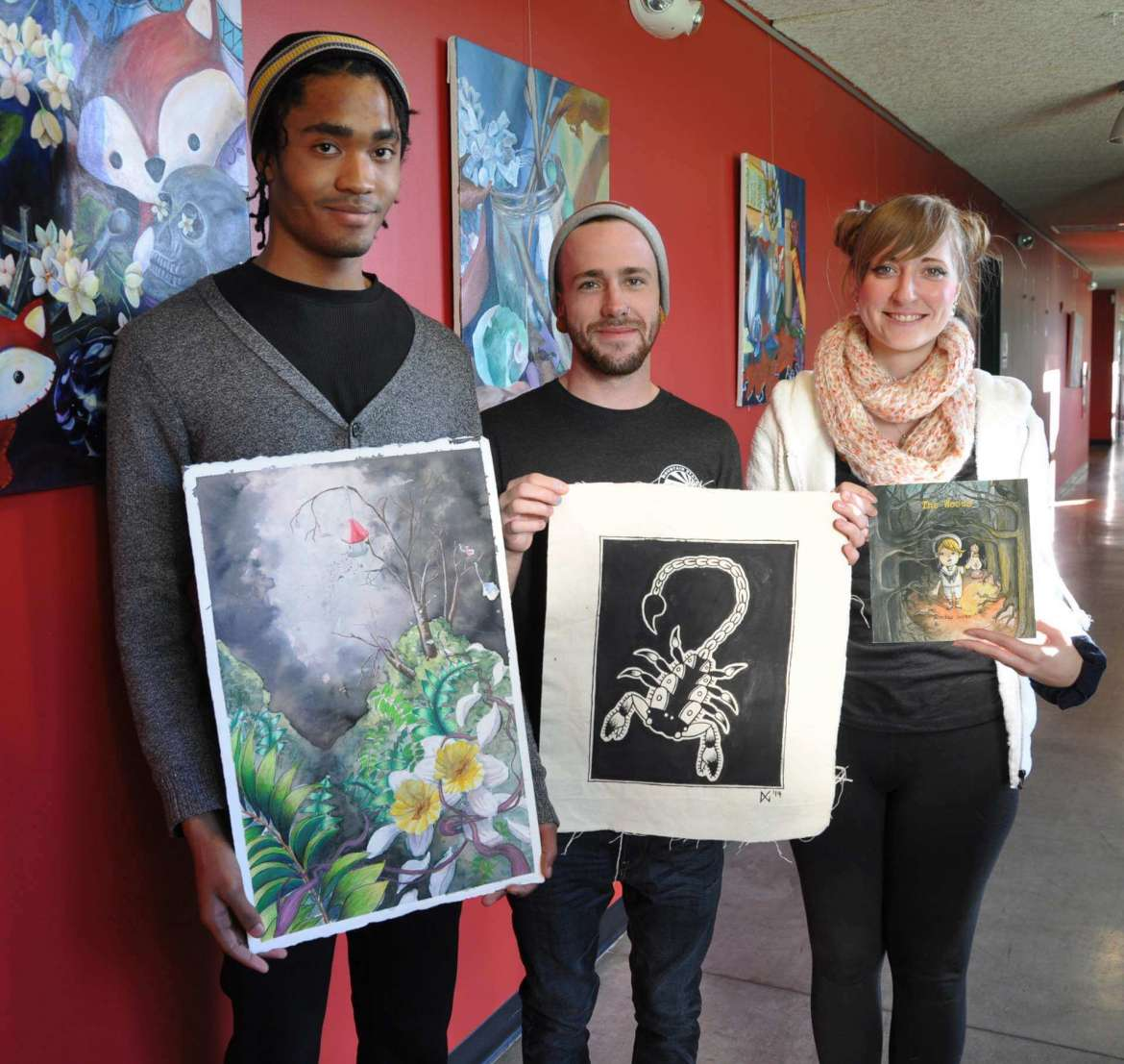 Shepherd University art students who are selling work at the 2nd annual Art Market December 5 include, left to right, Caliph Green of Winchester, Virginia, Wilson Gross of Morgantown, and Dorothy Gertz of Hagerstown, Maryland.