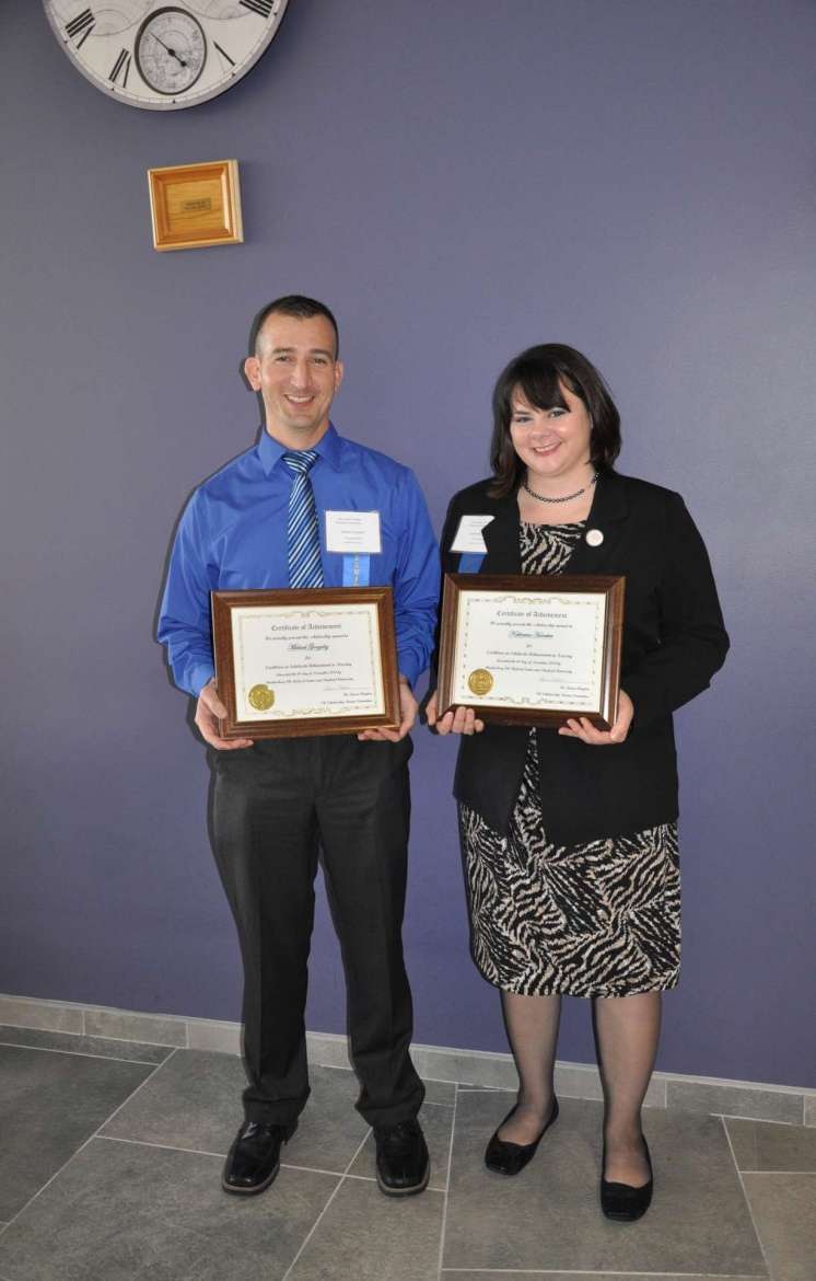 Michael Gonzalez (left) and Katherine Hovatter, Shepherd University nursing students, each received a $300 scholarship during the 6th annual nursing research conference.