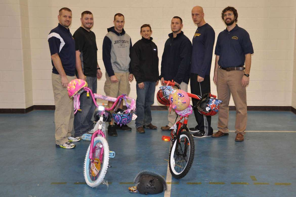 """Shepherd University health and physical education students organized """"Peddling for Success"""" to raise money to buy bicycles for deserving children in Jefferson County. They are (left to right) Will Jenkins, Inwood; Bobby Lanham, Charles Town; Daniel Powell, Hagerstown, Maryland; Corey Mongan, Hagerstown, Maryland; Aaron Staats, Winchester, Virginia; Nate Socks, Middletown, Maryland; and Dr. Jared Androzzi, assistant professor of physical education."""