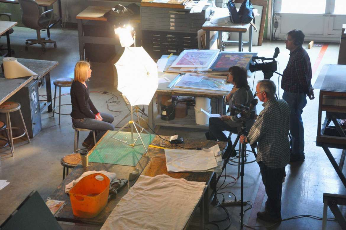 Shepherd University artist-in-residence Susan Carney discusses her work with the producers of ArtVoiceWV during a video shoot in November at the Center for Contemporary Arts printmaking studio.