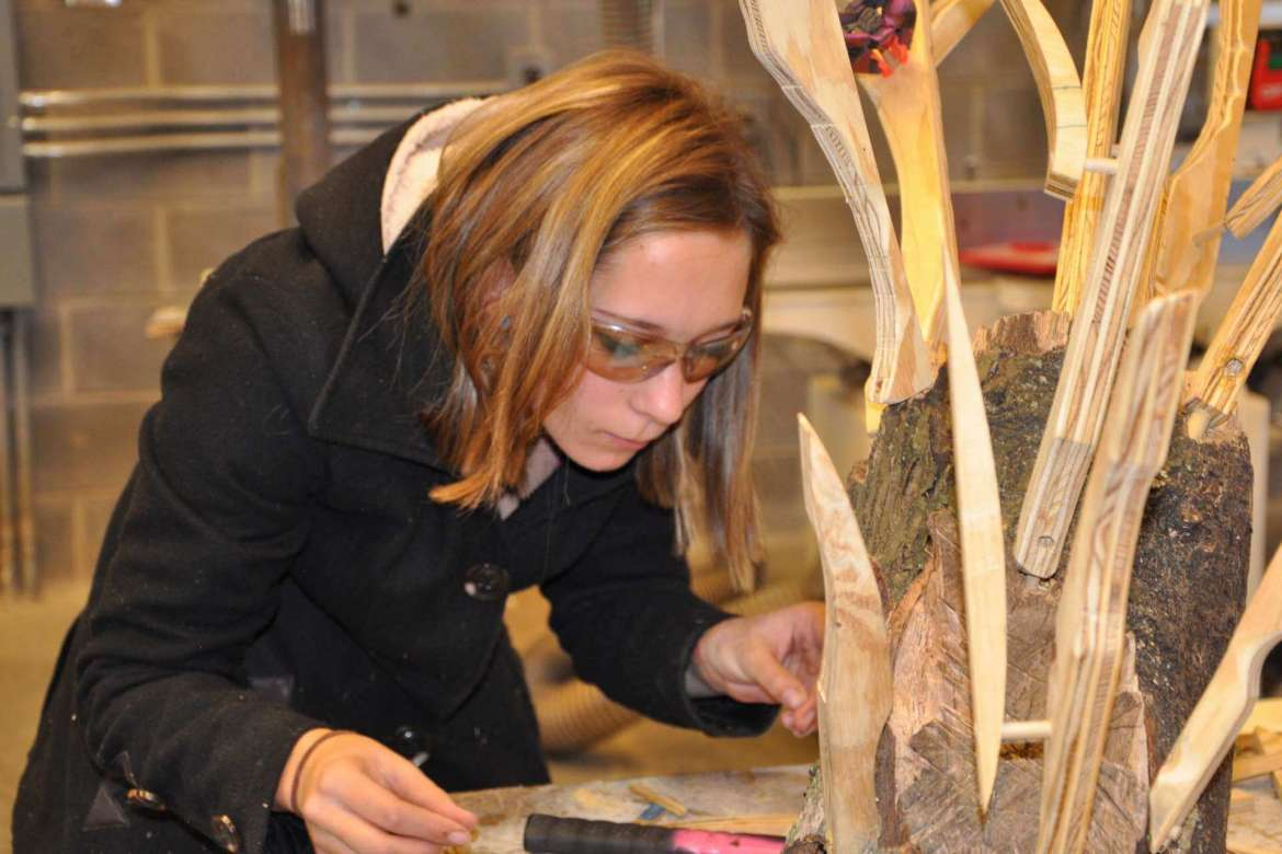 Student Alyssa Imes of Emmittsburg, Maryland, works on a project in the sculpture studio.