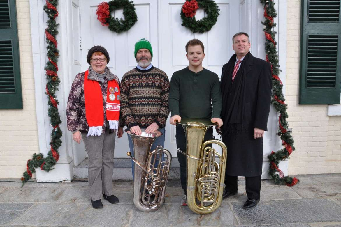 Preparations are underway for the fourth annual TubaChristmas at Shepherd University on Saturday, December 20, at 1 p.m. (left to right): Dr. Kathleen Corpus, assistant professor of family and consumer sciences, and Dr. Keith Alexander, assistant professor of history, are organizing the event. Anthony Makusky, music education major, plans to participate and Dr. Scott Hippensteel, assistant professor of music and director of bands at Shepherd, will serve as director.