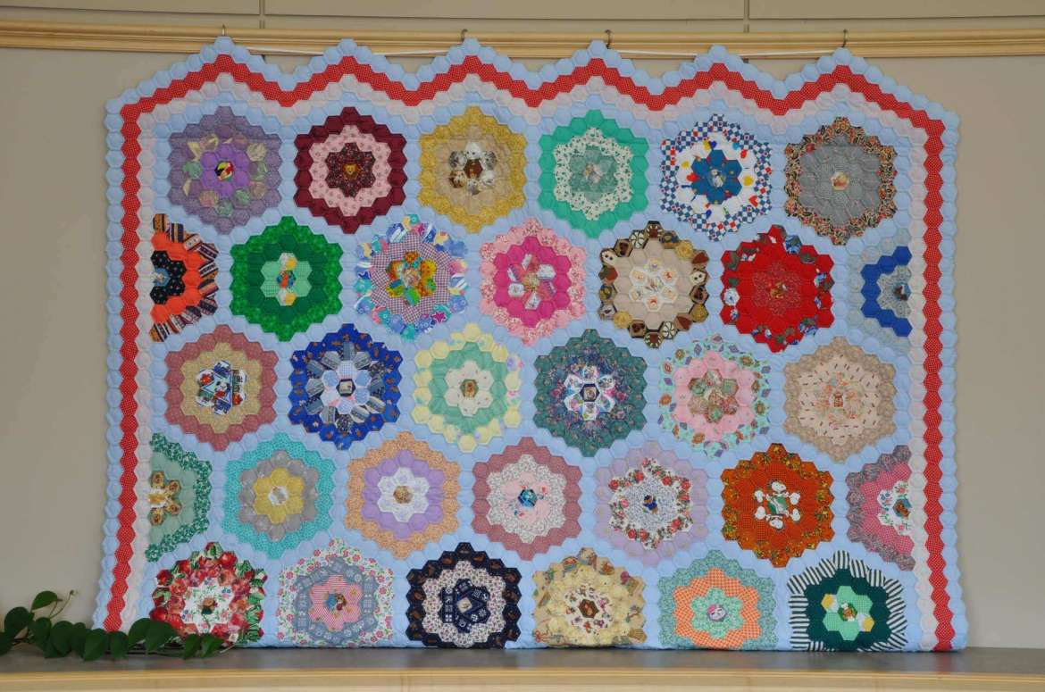 This quilt on display in the Scarborough Library Reading Room is the only handmade quilt in the exhibit. It was made by Mildred Rohrer, who at one time worked as a seamstress in the Hagerstown, Maryland, dress factories.
