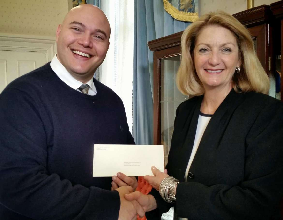 Monica Lingenfelter, executive vice president of the Shepherd University foundation, accepts a $5,000 gift from Edward Garofalo, eastern territory manager of Scott Electric, a regional wholesale electrical wholesale distributor with a new satellite office in Hagerstown, Maryland.