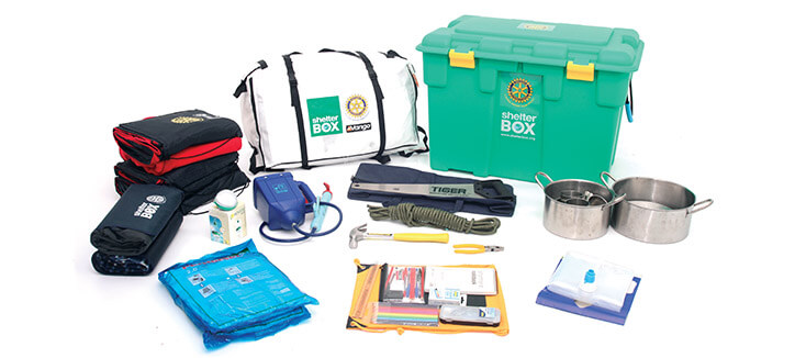 A ShelterBox contains a family-size tent and items such as bedding, kitchen supplies, tools, mosquito netting, and a water purification kit. They are distributed to people living in areas where disaster strikes. Photo from ShelterBox USA.