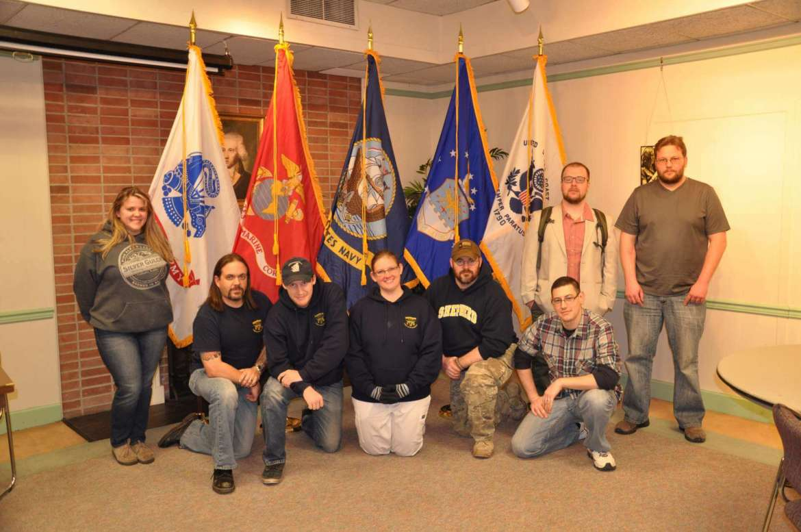 Members of the Shepherd University Student Veterans Organization pose in front of the new service flags the organization bough. (left to right) Megan Rogers, Chris Barnhart, Tony Smith, Gette Blanda, Bill Hall, Jacob Cordova, (standing) Dustin McDonnough, Andrew Flowers.