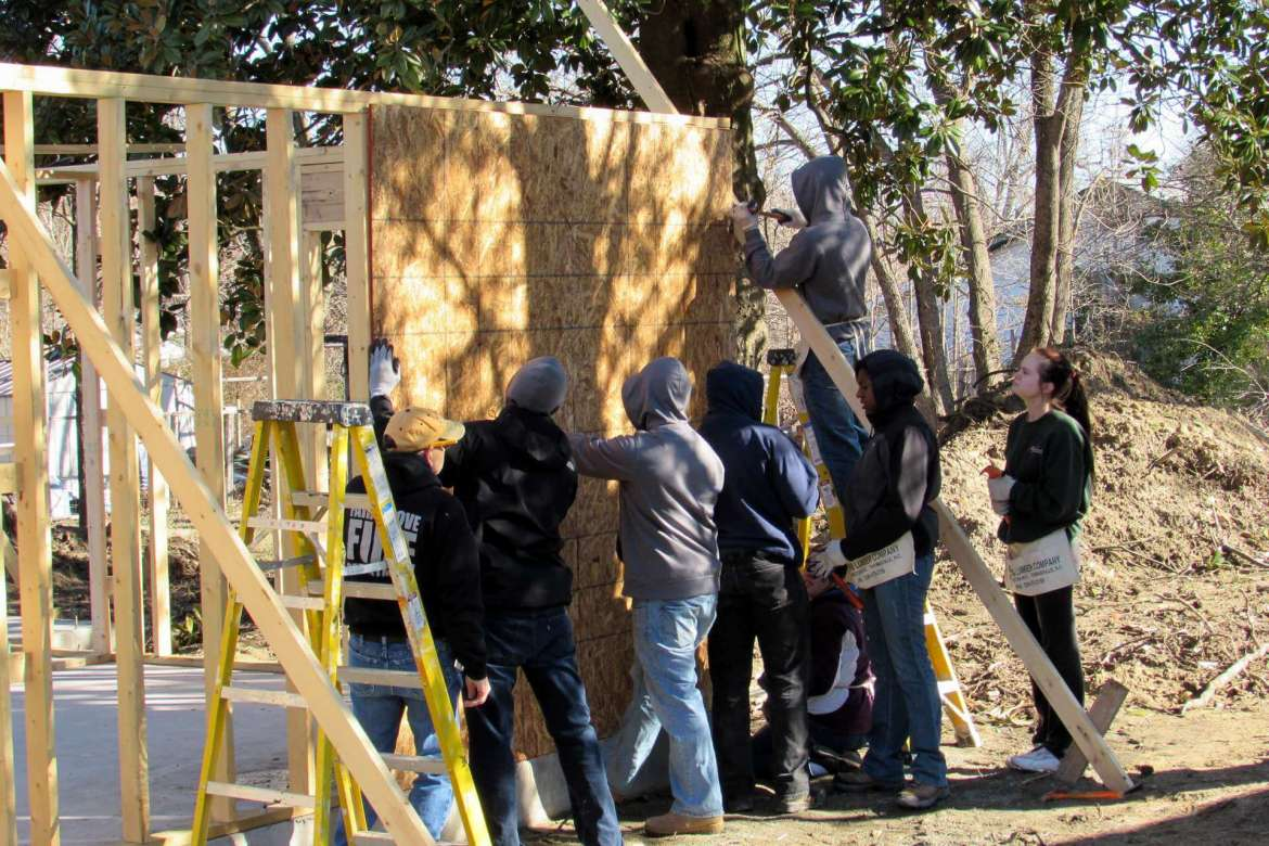 Shepherd University students help construct a Habitat for Humanity house during a previous Alternate Spring Break.