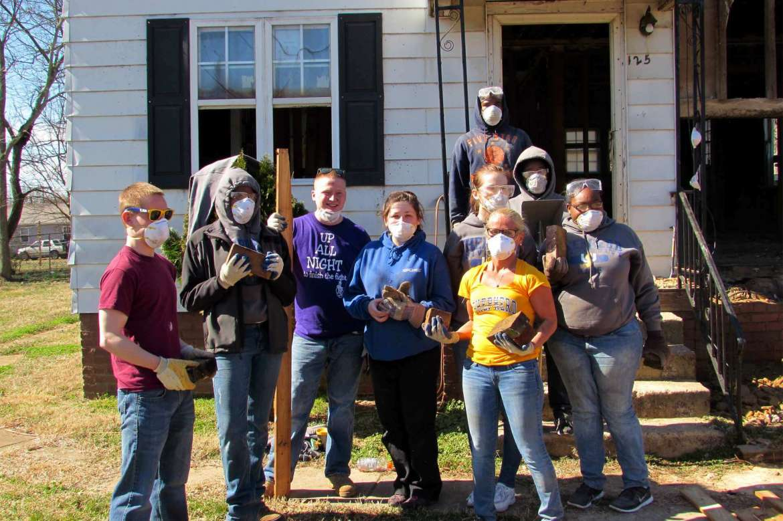 During Alternate Spring Break Shepherd students also help make much-needed repairs to houses.