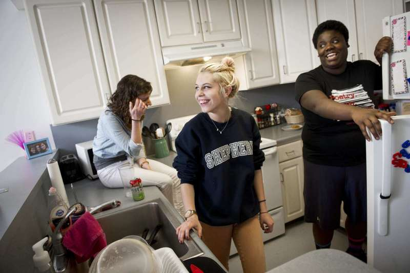 Students in the Kitchen at Dunlop and Printz residence halls which feature apartment-style living, including kitchen, living room, and bathroom facilities in each unit.