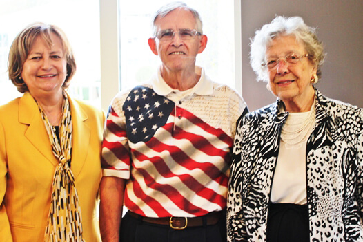 Women for Shepherd planning committee member Judy Childs '71, presenter Donald Watts, and planning committee member Betty Lowe '52,