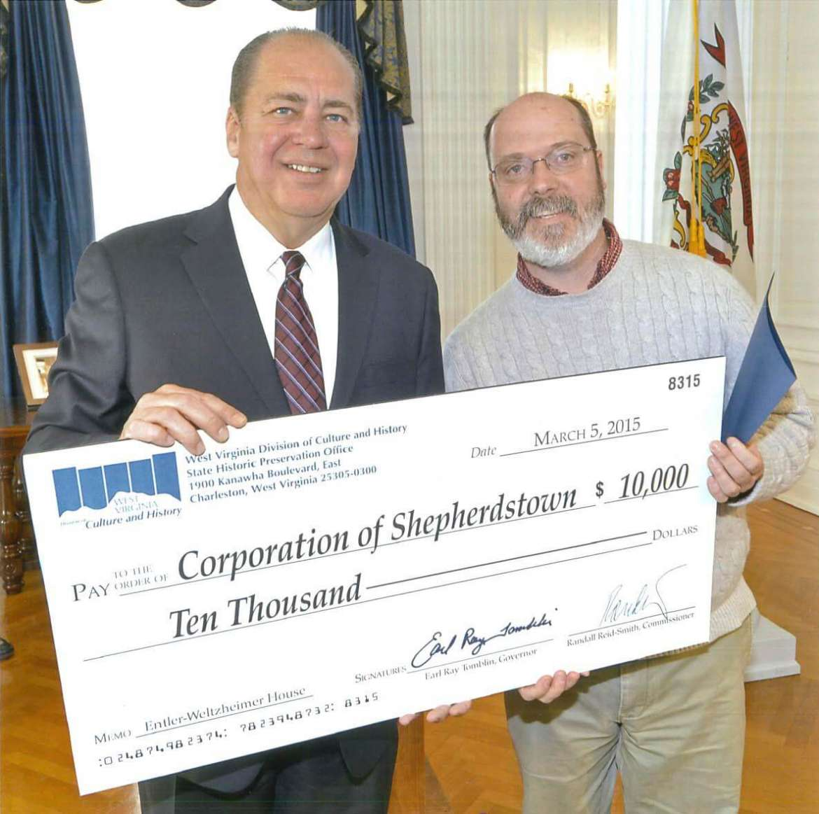 Dr. Keith Alexander, assistant professor of history, receives a check from Gov. Earl Ray Tomblin for a $10,000 survey and planning grant from the West Virginia Division of Culture and History to draw up plans to use the Yellow House as a center for preservation education.
