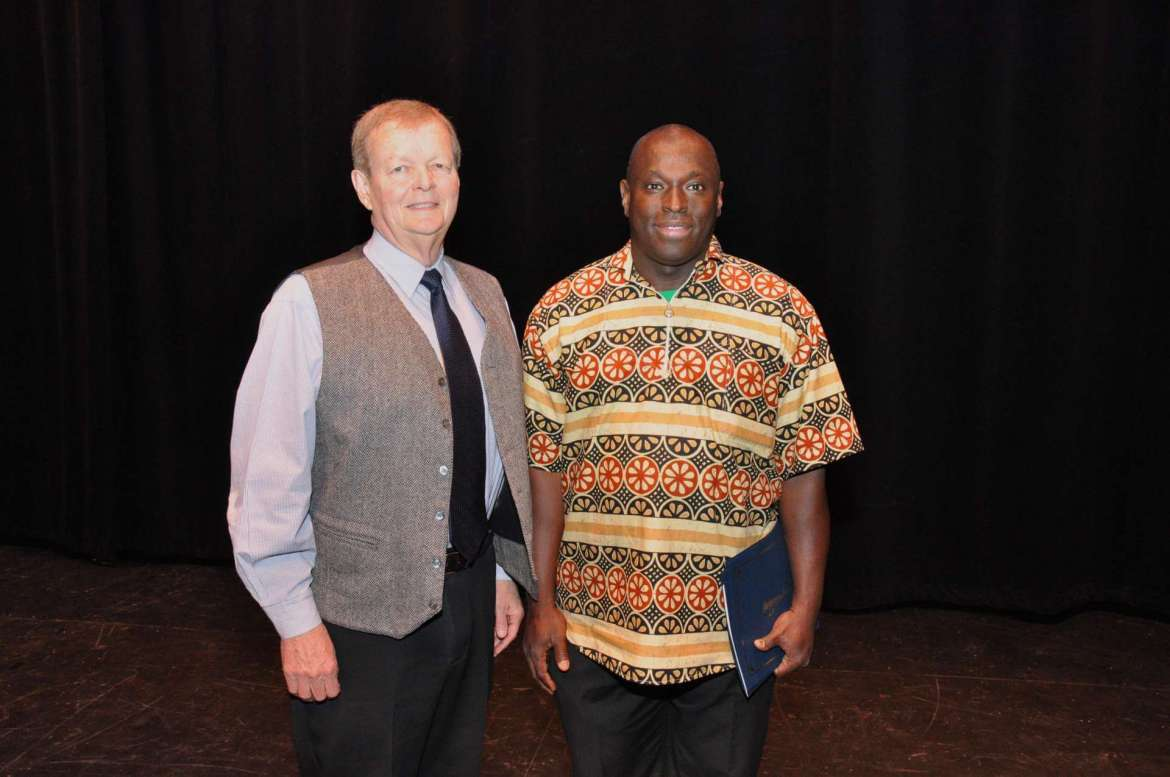 Siriki Diabate (right), an M.B.A. student living in Shepherdstown who is originally from Ivory Coast, received the Lowe Family Award, from Ken Lowe '71, (left) which honors students for high academic achievement and outstanding service to the university. A tree will be planted on Shepherd's campus in honor of Diabate.