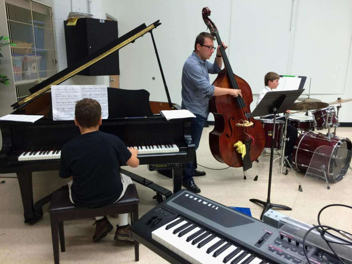 Kevin Pace, an adjunct music professor who teaches jazz improvisation and coaches several Shepherd combo ensembles, works with students during the 2014 summer Jazz Camp for students in grades 6-12 which takes place this year June 22-26.