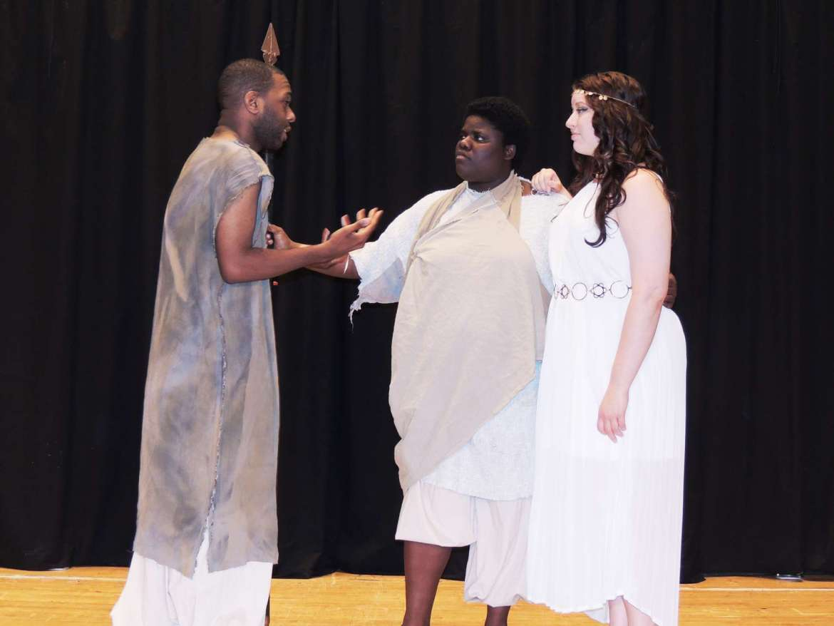 """Rehearsing for """"Helen"""" are (l. to r.) Jake Anderson, who plays both the Dioscuri Pollux and the Greek messenger, LaShawn Tolson as Menelaus, and Caitlin Shambaugh as Helen."""