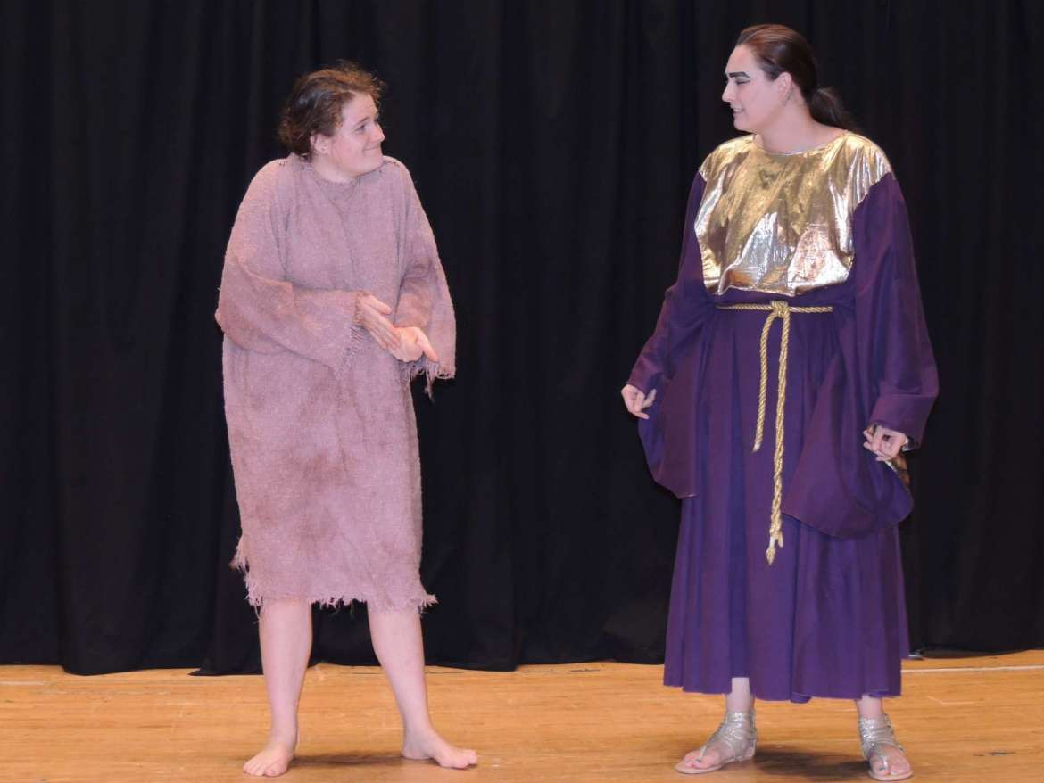 """Ellie Didden as the Egyptian messenger and Shelby Taylor as Theoclymenus perform in the Rude Mechanical's performance of """"Helen."""""""