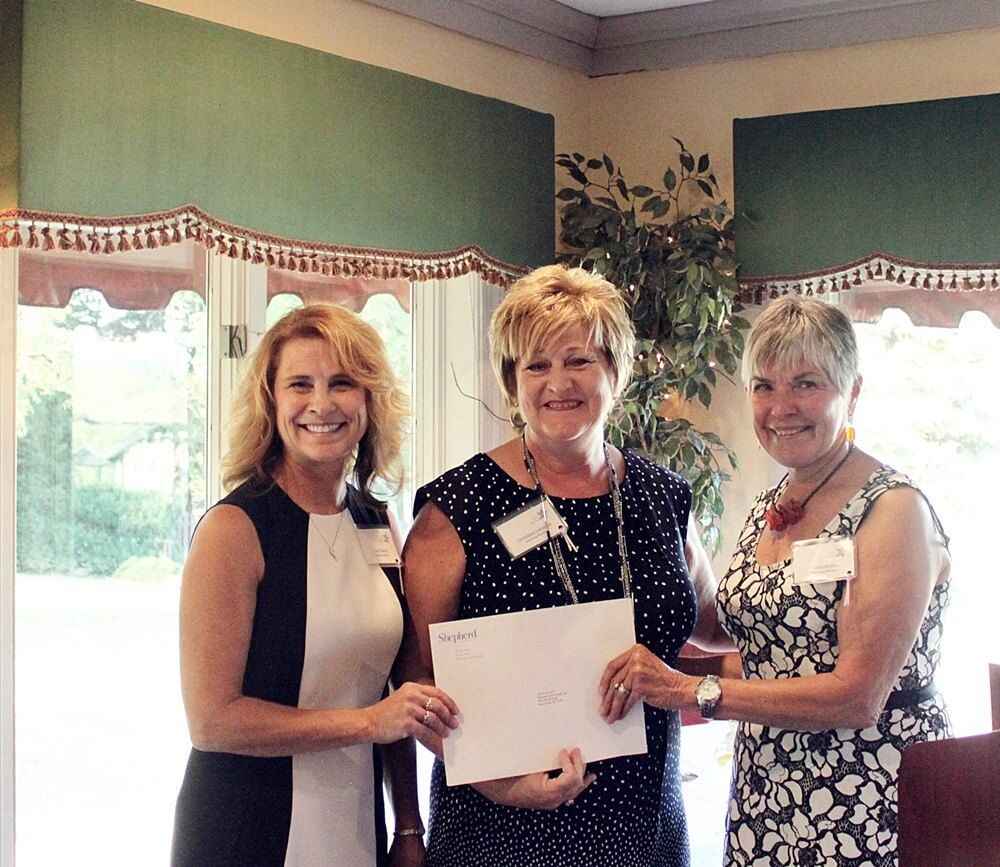 Panhandle Home Health, Inc. Executive Director Lisa Bivens (l) and Director of Development Christina Johnson (m) receive the WISH nonprofit grant from Grants Committee Vice-Chair Carol Kable (r).