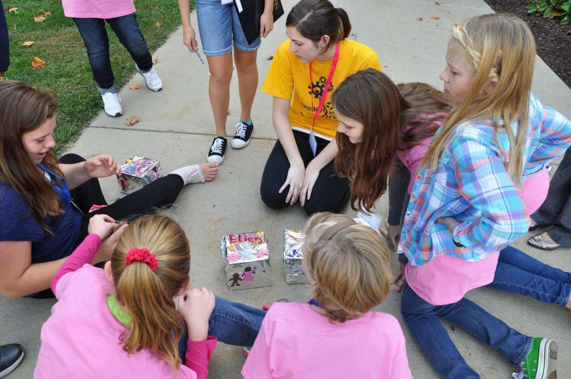 Middle school-age girls who attended last year's Seeding Your Future conference prepare packages to send up in a hot air balloon during a workshop conducted by Shepherd's Balloon Club.
