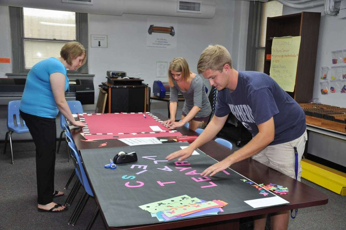 Students in Shepherd University's Delta Psi chapter of Kappa Delta Pi, the international honor society in education, work on posters for presentations they will give during the bienniel Kappa Delta Pi Convocation. Pictured from left to right are Chelsea Wilson, Baker; Jordyn Marion, Myersville, Maryland; and Bradley Davidson, Manchester, Maryland.