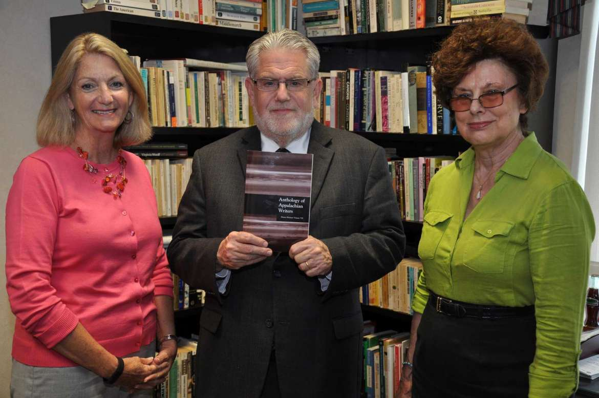 "Displaying a copy of the ""Anthology of Appalachian Writers: Homer Hickam Volume VII"" are (l. to r.) Monica Lingenfelter, executive vice president of the Shepherd University Foundation, Dr. Chris Ames, vice president for academic affairs, and Dr. Sylvia Shurbutt,  professor of English and senior managing editor of the anthology."