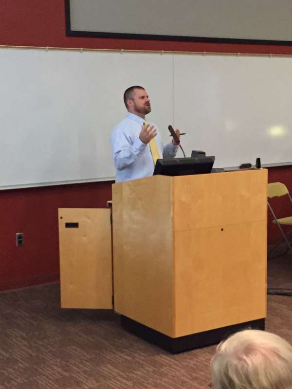 """Dr. Robert M. Anthony provides the audience with basic migration theories at the Political Science """"Teach-In on Immigration."""" (10/3/15)"""