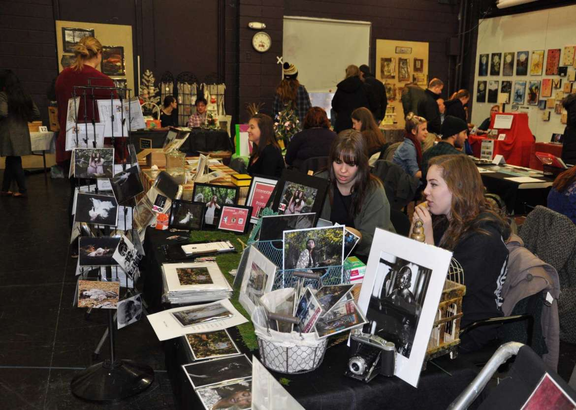 Shoppers browse for artwork and crafts made by Shepherd University students and faculty during the 2014 Art Market.