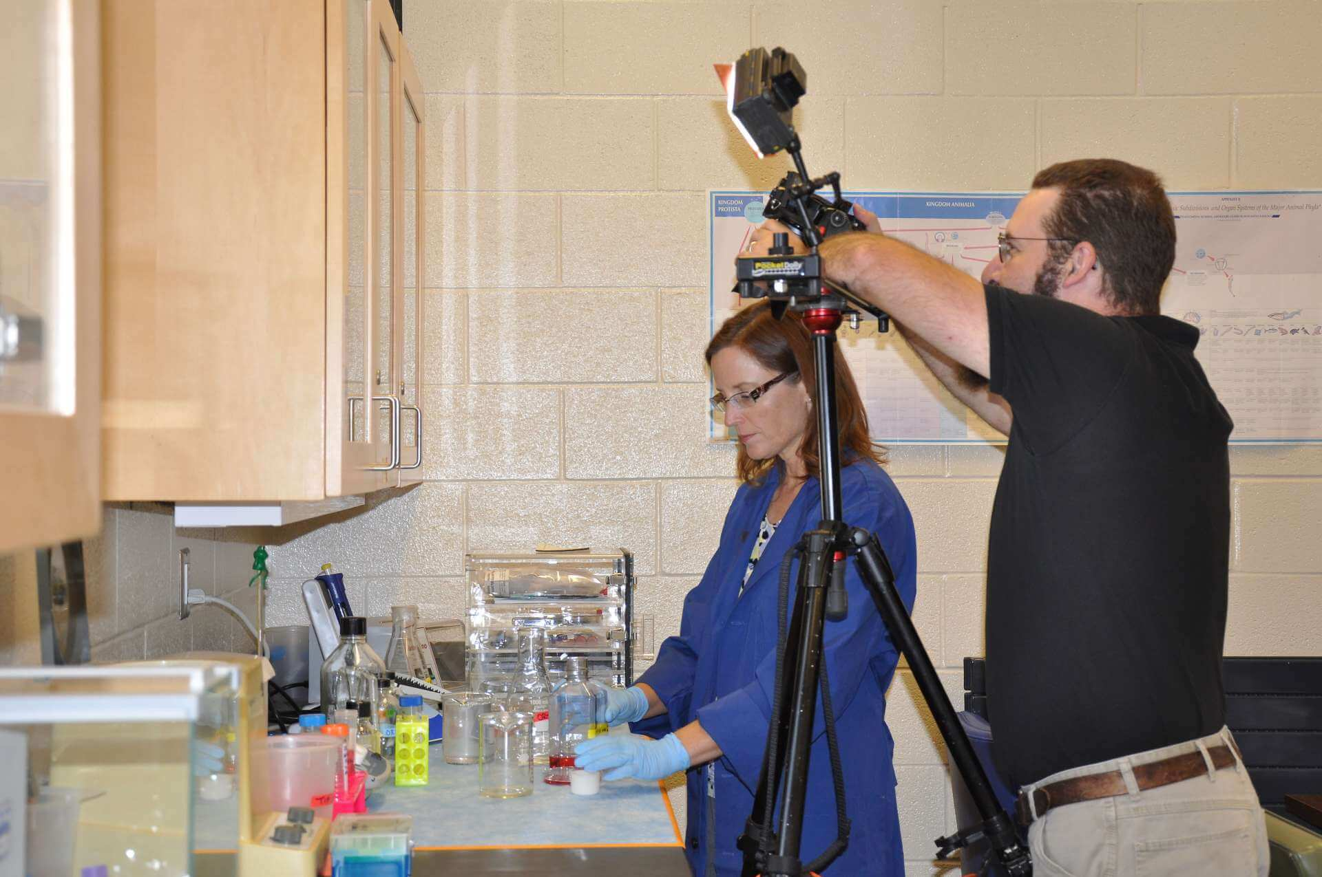 Dr. Carol Plautz, associate professor of biology, demonstrates a research technique for use in a video in the Journal of Visualized Experiments (JoVE).