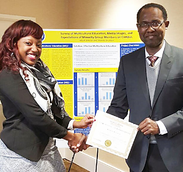 Shamika Bruinton, a sociology major from Woodbridge, Virginia,  (left) receives a certificate of appreciation from Eric Schwartz, executive director of Advena World LLC, for research she presented at the Advena World International Conference December 9 in Washington, D.C.