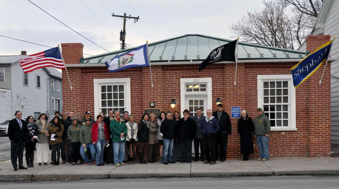 Members of Shepherd's University's Student Veterans Organization and the Shepherd Fund Leadership Giving Circle attended a ribbon cutting and open house to celebrate the new Veterans Center on Princess St. in Shepherdstown.