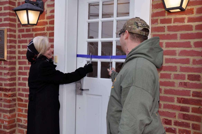 Dr. Sylvia Manning, interim president, and Matt Garman, Shepherd University Student Veterans Organization president, cut the ribbon on the new Veterans Center.