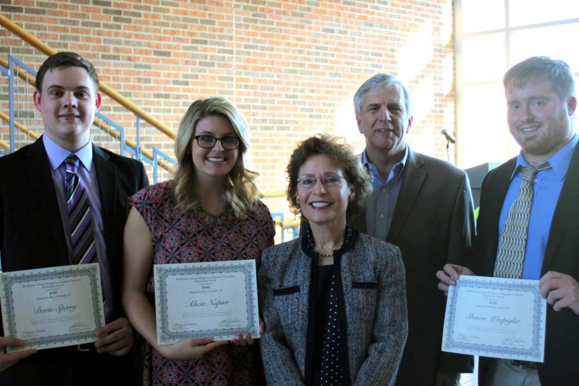 The first recipients of the BrickStreet Scholars Program at Shepherd University pose with President Mary J.C. Hendrix and Greg Burton, CEO of BrickStreet Mutual Insurance. Shown with their award certificates are Devin Sperry, Alicia Napier, and Shawn Winpigler. (from l. to r.)