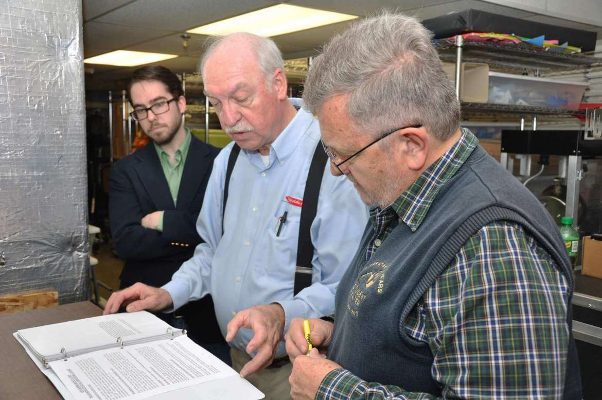 Charles Reynolds with Maas-Rowe Carillons, Inc. (middle) instructs Mark Adelsberger (left) and Don Rohel on how to operate Shepherd's new digital carillon.