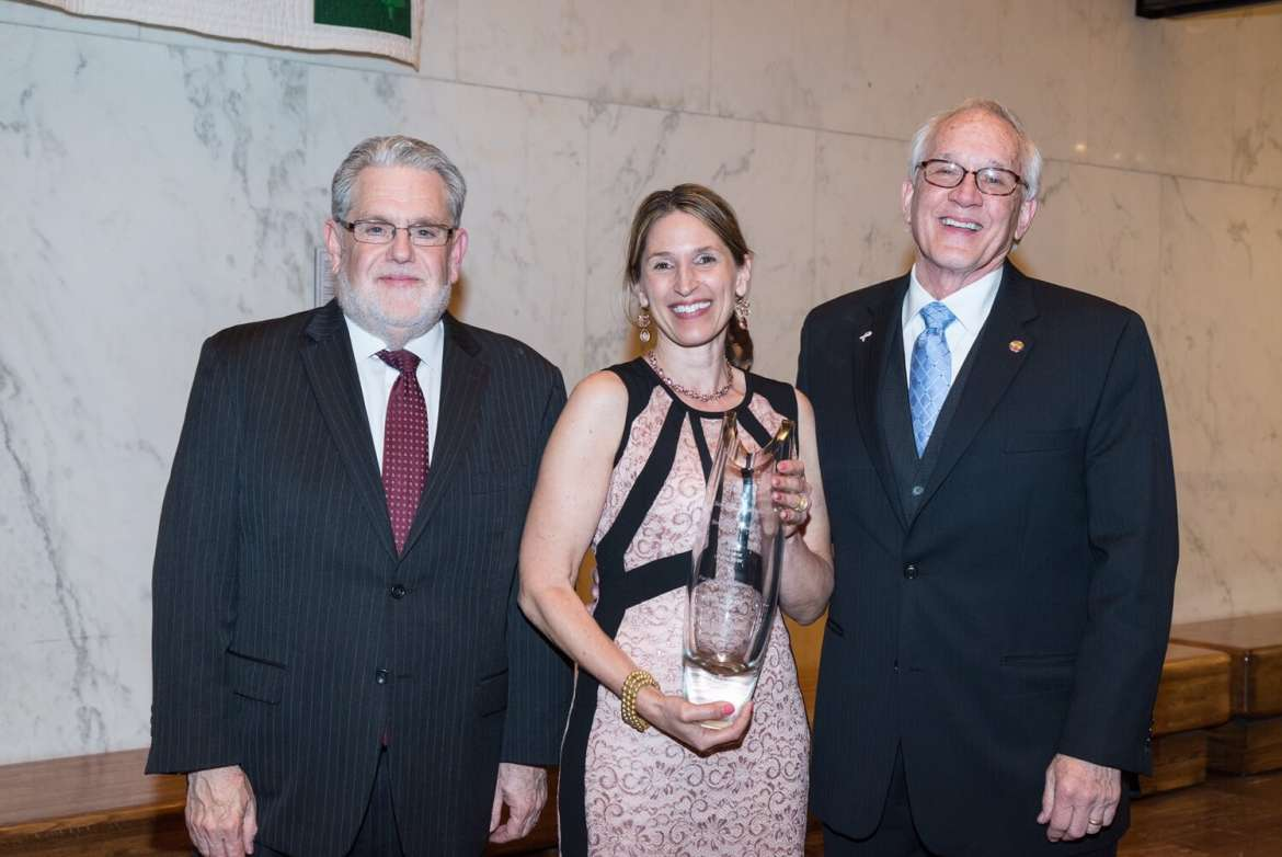 Sonya Evanisko, 2015 West Virginia Professor of the Year, with Dr. Chris Ames (l.), provost, and Dow Benedict, dean of the School of Arts and Humanities. Photo by Michael Keller.