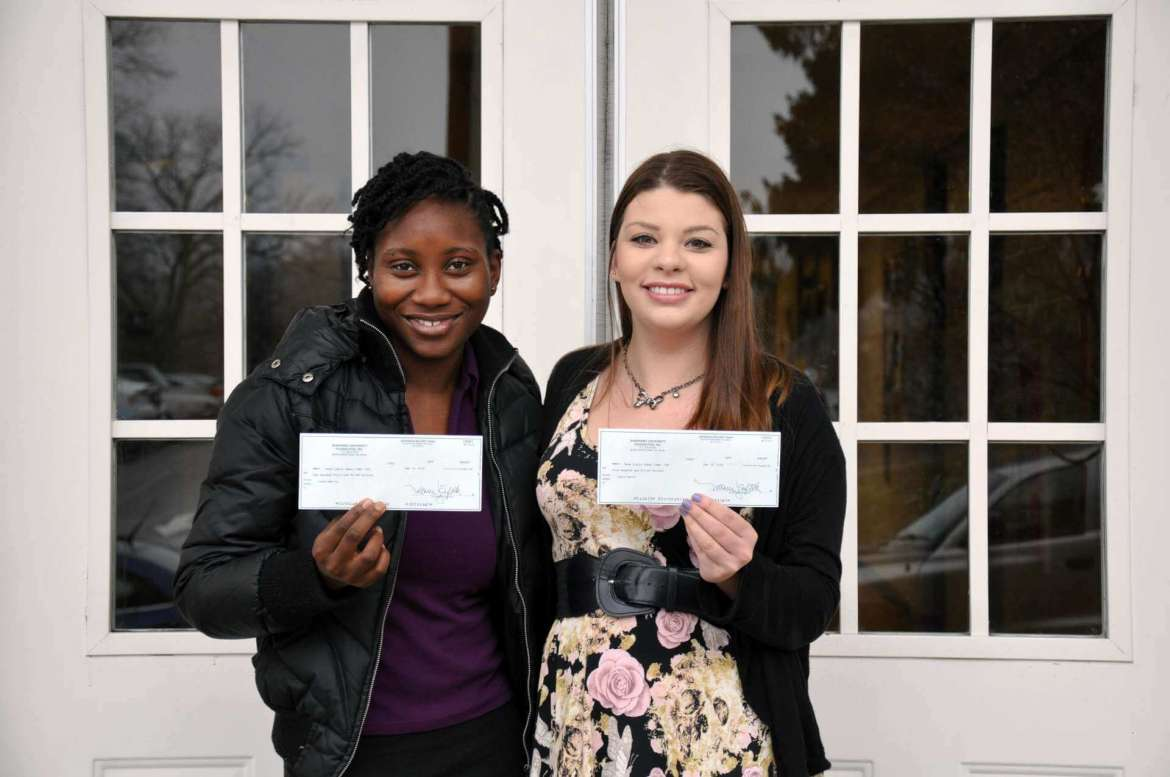 Two winners in this year's congressional term limits research paper competition are Irene Macfoy (left), Clifton, New Jersey, honorable mention; and Laura Knock, Kearneysville, second place. Not pictured are Jocelyn Robinson, Charles Town, first place; Benjamin Gregory, Berkeley Springs, second place; and Julian Crawford, Falling Waters, participant award.