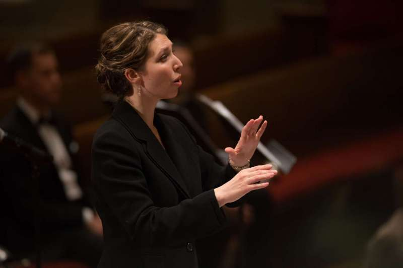 Carlson conducting photo