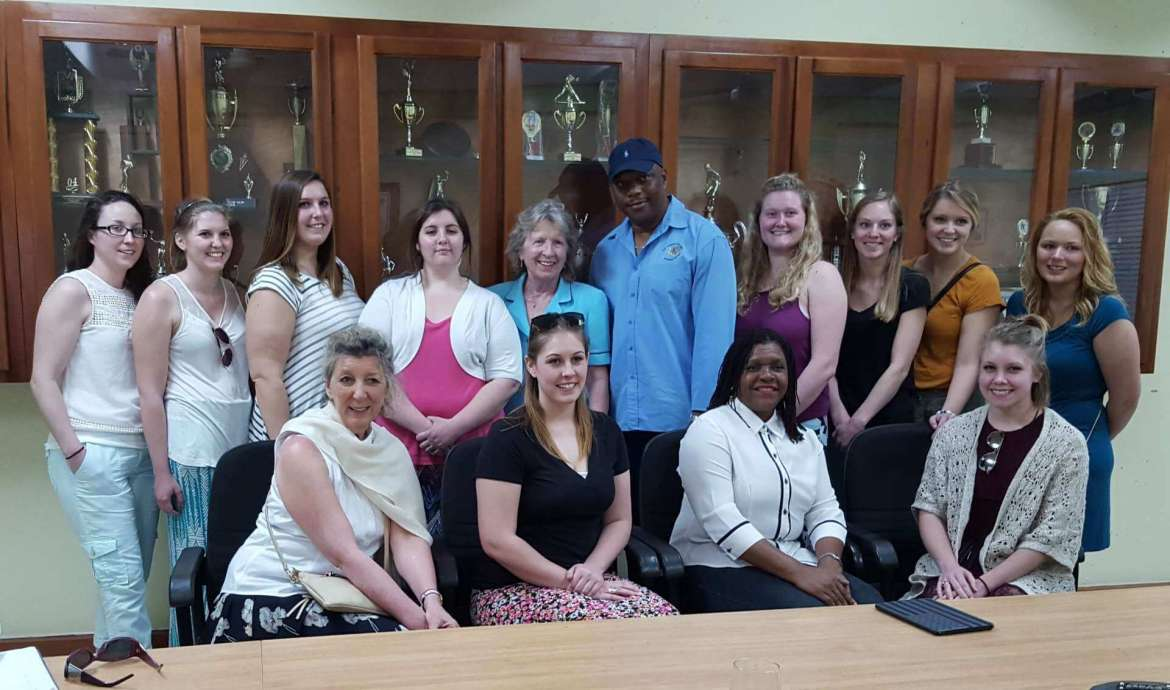 Shepherd students and faculty who went on the March 9-20 trip to Jamaica include (front row, l. to r.) Dr. Mary Coyle, assistant professor of nursing; Jessi Smith, a nursing student from Cedarville; Leodis Douglas, human resources director at G.C. Foster College, Spanish Town, Jamaica; Jordyn Marion, an education student from Myersville, Maryland, (back row) Keri Leach, a nursing student from York, Pennsylvania; Cara Doupnik, a nursing student from Easton, Maryland; Kayla Howeth, a nursing student from Cordova, Maryland; Sarah Kidwell, an education major from Short Gap; Dr. Virginia Hicks, dean of the School of Education and Professional Studies; Maurice Wilson, vice principal academics and olympic coach at G.C. Foster College, Spanish Town, Jamaica; Amanda Shields, a nursing student from Charles Town; Emily Funkhouser, a nursing student from Martinsburg; Madeline Witte, an education student from Hurricane; and Heather Giles, an education student from Gore, Virginia.