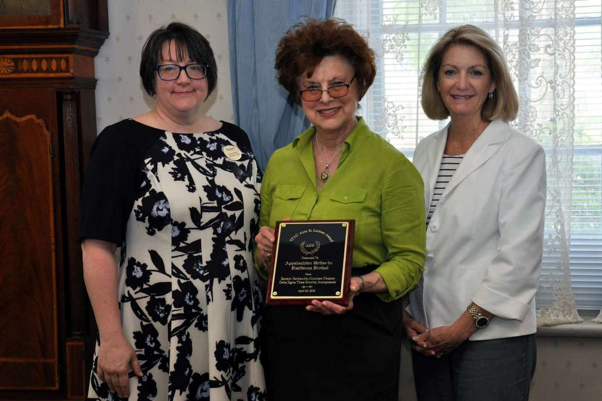 Shepherd University's Appalachian Heritage Writer-in-Residence Project has been awarded an Arts and Letters Award by the Eastern Panhandle Alumnae Chapter of Delta Sigma Theta sorority. Pictured, from left, are Rachael Meads, director of the Performing Arts Series at Shepherd, Dr. Sylvia Bailey Shurbutt, professor of English and coordinator of the Appalachian Studies Program, and Monica Lingenfelter, executive vice president of the Shepherd University Foundation.