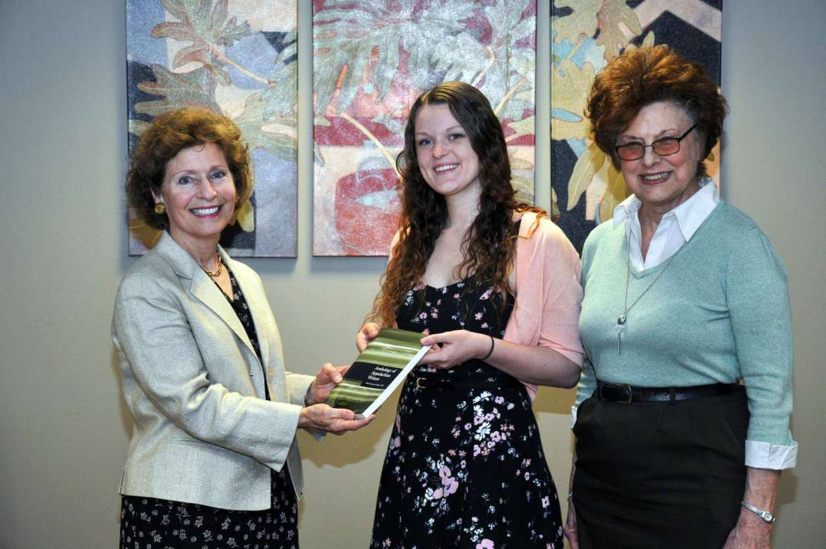 "Danielle Carder (center), a secondary education major from Ridgeley and editor of this year's ""Anthology of Appalachian Writers, Nikki Giovanni Volume VIII"" and Dr. Sylvia Bailey Shurbutt (right), managing editor, present Shepherd University President Mary J.C. Hendrix  with a copy of the book."