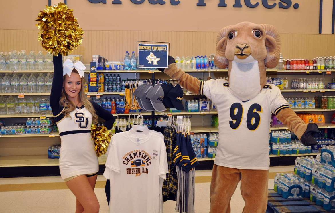 Jennifer Blanchard (left), a science education major from Hedgesville and Shepherd cheerleader, poses with Rambo at the Shepherd merchandise display in a Martinsburg Food Lion.