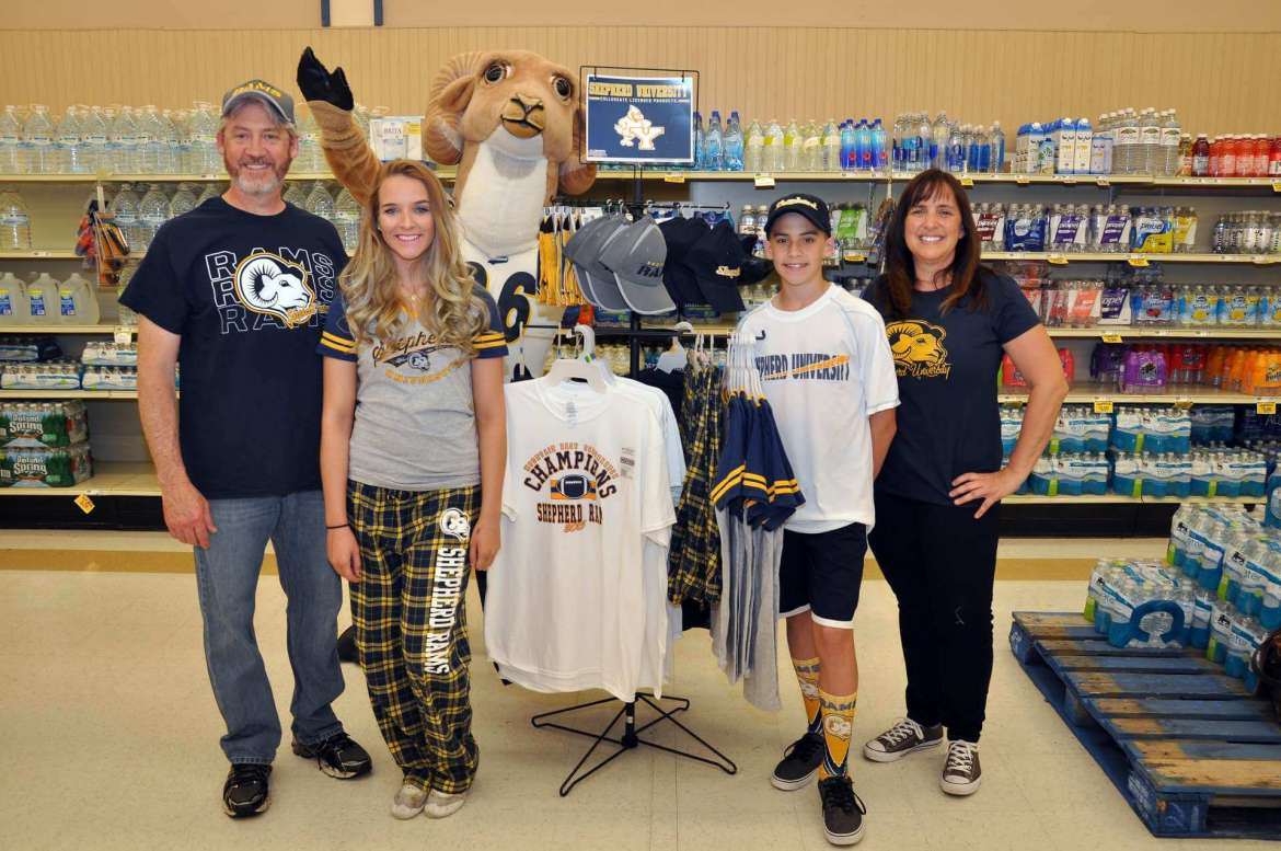 Rambo photobombs a picture of (from left) Mark Roemer, Shepherd alumnus, Jennifer Blanchard, a science education major from Hedgesville, Nathan Roemer, and Beth Binns-Roemer, Shepherd alumna.