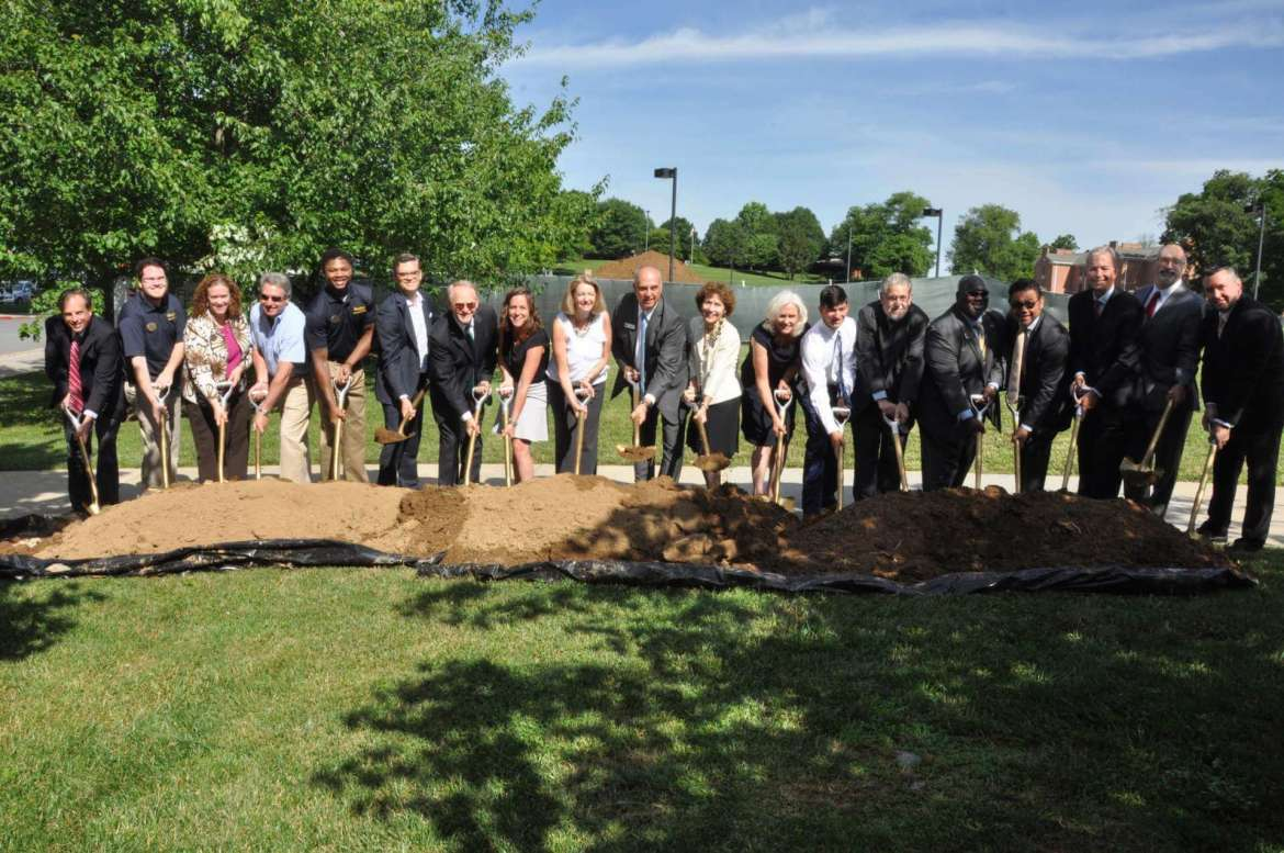 Participants in the groundbreaking for Shepherd University's new residence hall included Jack Shaw, assistant vice president for auxiliary enterprises; Kahlen Browning, Student Government Association representative; Dr. Liz Sechler, director of residence life; Mike Smith, president of the Shepherd University Foundation; DaShawn Long, Student Government Association representative; Luis Bernardo, architect with Design Collective; Dr. Paul Hill, chancellor, West Virginia Higher Education Policy Commission; Christine Hewett, community relations manager for Sen. Joe Manchin; Monica Lingenfelter, executive vice president, Shepherd University Foundation; Tom Trubiana, EdR president; Dr. Mary J.C. Hendrix, Shepherd University president; Dr. Marcia Brand, chair, Shepherd University Board of Governors; Camden Connell, student; Dr. Chris Ames, provost; Dr. Tom Segar, vice president for student affairs; James Vigil, vice president for administration; Timothy McShea, Shepherd University Foundation board of directors member; Mike Mallow, Harkins Builders; and Eric Shuler, director of facilities management.