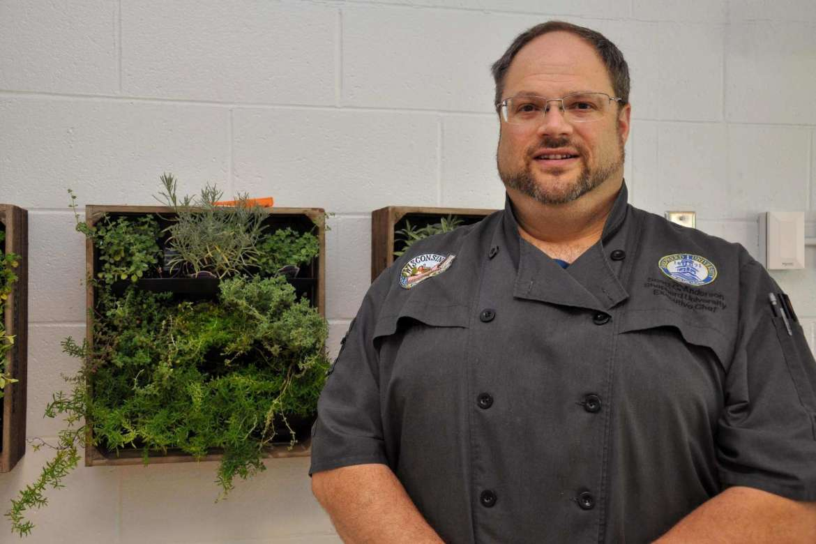 Scott Anderson, assistant dining services director, has stocked the dining hall's new herb wall with a variety of herbs that cooks and students can add to dishes