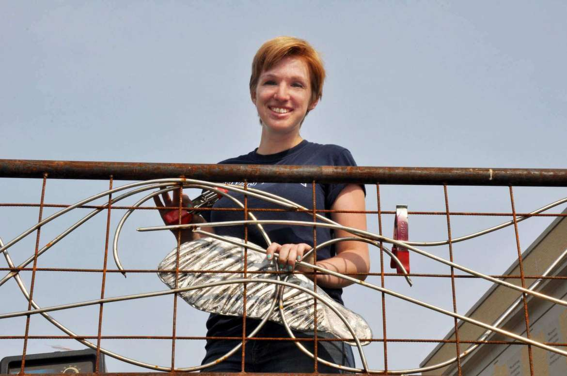 Erin Bennett, who graduated in May with a B.F.A. in photography and a B.F.A. in sculpture, designed a railing that is being installed behind the Robert C. Byrd Science and Technology Center.