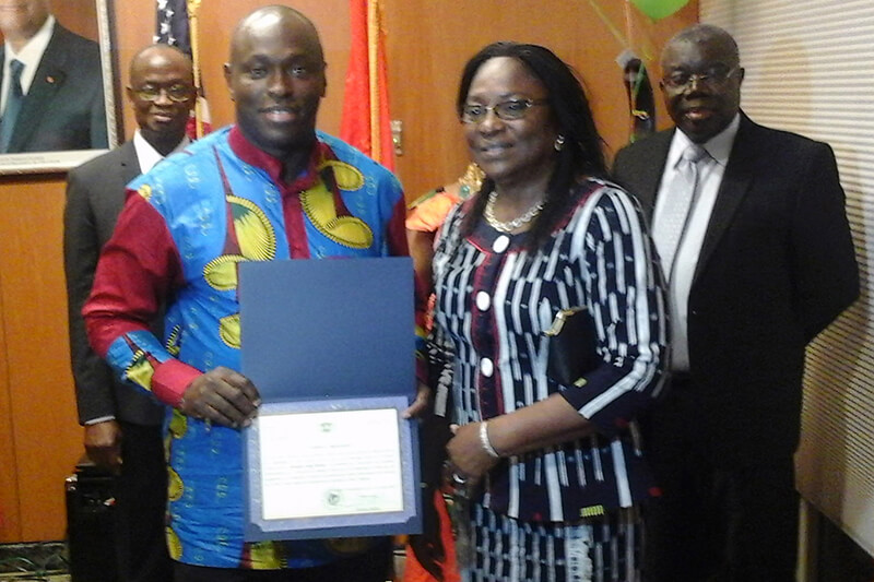 Shepherd University M.B.A. student Siriki Diabaté was recently honored by the embassey of his home country, Cote d'Ivoire, for his leadership at Shepherd and in the community. Diabaté is shown receiving his certificate from the wife of Ambassador Diabaté Daouda, Cecile Diabaté, as the ambassador (l.) looks on. Also pictured is  Ambassador Bockari Kortu Stevens (r.), from Sierra Leone.