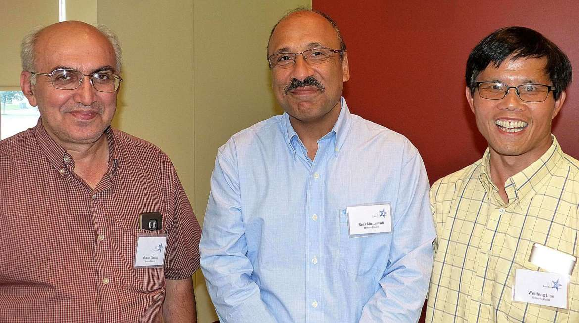 Developing a Robotics Curriculum, represented by (l. to r.)  Professors Osman Guzide, Reza Mirdamadi, and Weidong Liao.
