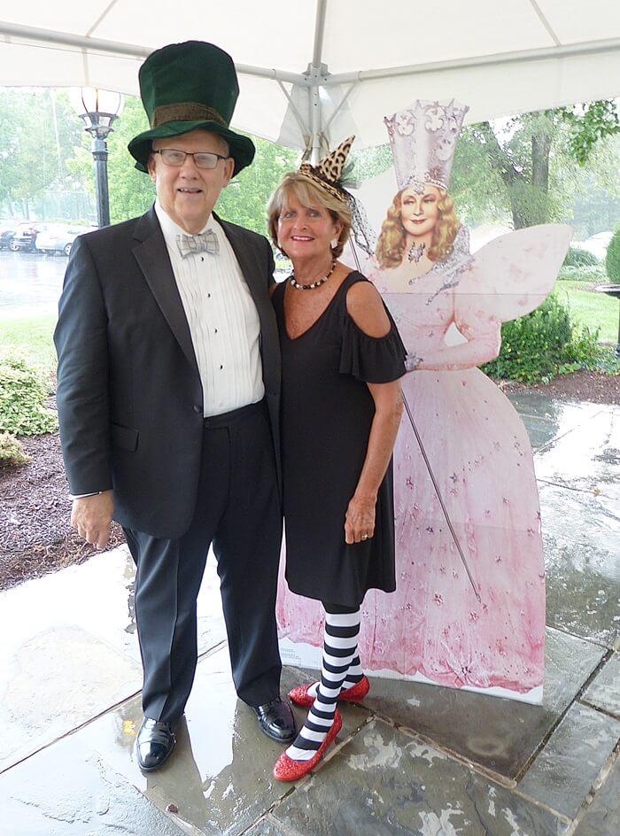Scarborough Society President Ray Alvarez '62 poses with Scarborough Society Gala Chair Sara Lueck `67 beside a life-size cutout of Glinda the Good Witch of the North. As emcee for the evening, Ray played the part of the Great and Powerful Oz, while Sarah opted for the Wicked Witch of the East (before her untimely demise).