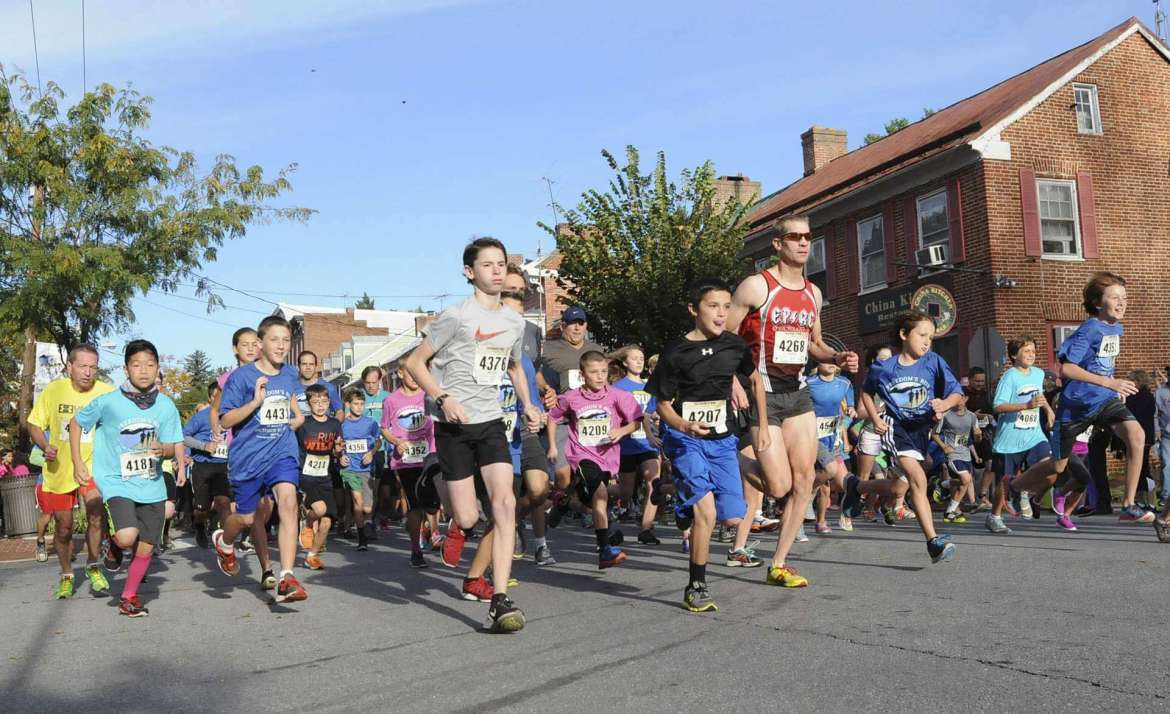 5k Runners begin down German Street at 9AM Sat. morning in Shepherdstown. See more photos on CU.journal-news.net. (Journal Photo by Ron Agnir)