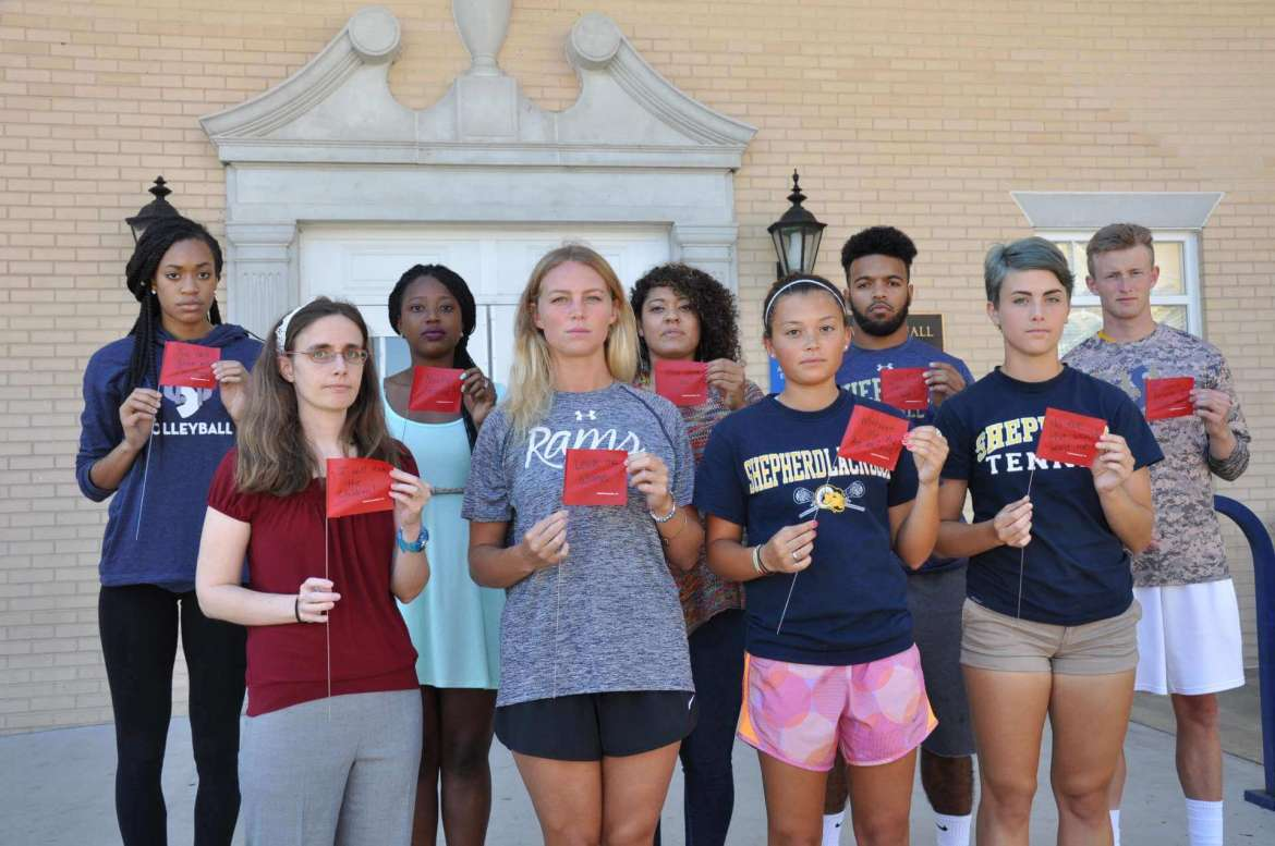 Participants in Shepherd University's Red Flag campaign to combat the problem of dating violence include (front row, l. to r.): Dr. Lindsey Levitan, assistant professor of psychology; Anna Munford, Purcellville, Virginia; Kiana Miller, Boonsboro, Maryland; and Molly Lovern, Bluefield; back row, Grace Simmons, Centreville, Virginia; Shamika Bruinton, Woodbridge, Virginia; Rachel Tysor, Martinsburg; C.J. Davis, Hagerstown, Maryland; and Grant Davis, Harpers Ferry.
